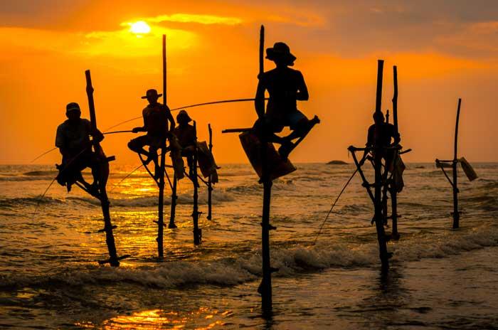 Fiskere ved solopgang